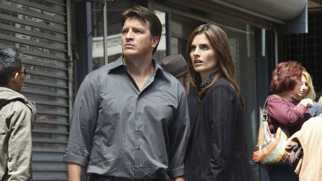 """CASTLE - """"Under the Gun"""" - When a coded document hidden by a murdered bail bondsman gets Castle's imagination running wild, Beckett must steer the case back to the violent felons who populated their victim's world - only to discover that maybe Castle's crazy theories aren't so crazy after all. Complicating matters is the surprise arrival of Beckett's ex-partner (now a bounty hunter). As the two reunite over a history that Castle has no part of, Castle is forced to watch the relationship take a turn towards the romantic, on """"Castle,"""" MONDAY, OCTOBER 4 (10:01-11:00 p.m., ET), on the ABC Television Network. (ABC/ADAM LARKEY) NATHAN FILLION, STANA KATIC"""